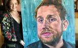 Claire Guinan with her portrait of singer Gavin James