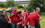 Edenderry players and supporters celebrate at the final whistle