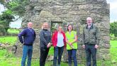 L. to r. Seamus Corcoran, Dora Corcoran, Cathy Moore, archaeologist, Dr Ellen O'Carroll, archaeologist, and Seán Corcoran at St Mella's Cell, Lemanaghan on Saturday morning.