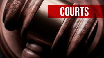 Man caught masturbating while standing at shop till is jailed