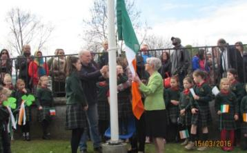 Scoil Mhuire read Proclamation and proudly raise Irish flag