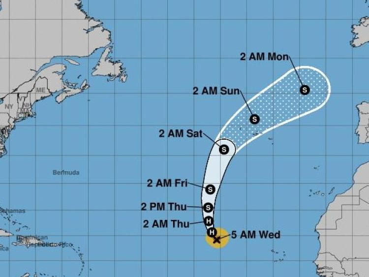Isaac winds slow to 45 miles per hour , heavy rain, high surf expected
