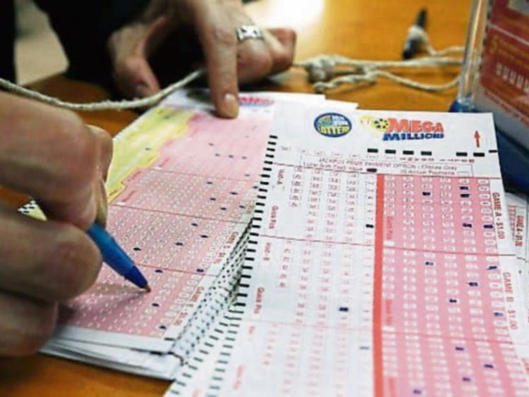 Players face agonising wait as TOO MANY tickets are sold for tonight's £141m EuroMillions meaning the draw is